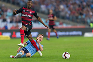SYDNEY, AUSTRALIA - APRIL 13: Sydney FC midfielder Brandon O'Neill (13) slides to tackle Western Sydney Wanderers midfielder Roly Bonevacia (28) at round 25 of the Hyundai A-League Soccer between Western Sydney Wanderers and Sydney FC  on April 13, 2019 at ANZ Stadium in Sydney, Australia. (Photo by Speed Media/Icon Sportswire)