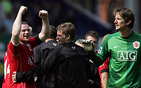 Photo: Paul Thomas.<br /> Everton v Manchester United. The Barclays Premiership. 28/04/2007.<br /> <br /> Wayne Ronney celebrates Utd's with team-mates Ole Gunnar Solskjaer and Edwin van der Sar after the final whistle.