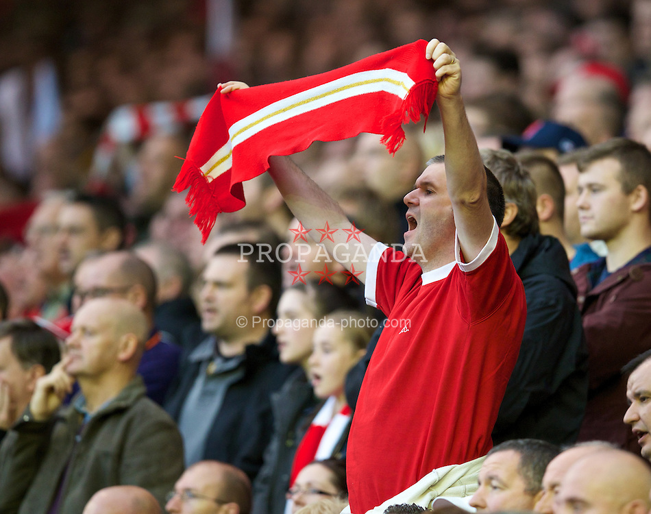 LIVERPOOL, ENGLAND - Saturday, October 26, 2013: As Liverpool celebrate 50 years of 'You'll Never Walk Alone' a fan sings the club's anthem after the Premiership match against West Bromwich Albion at Anfield. (Pic by David Rawcliffe/Propaganda)