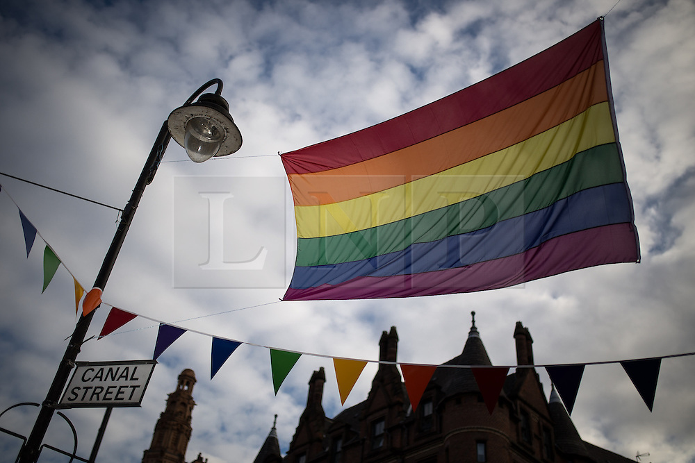 """© Licensed to London News Pictures . 22/08/2014 .  Manchester , UK . Rainbow flag on Canal Street . Manchester Pride """" Big Weekend """" in Manchester's """" Gay Village """" today ( 22nd August 2014 ) . Photo credit : Joel Goodman/LNP"""