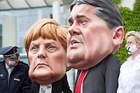 """01 MAY 2014, BERLIN/GERMANY:<br /> Angela-Merkel und Sigmar-Gabriel-Darsteller während einer  Prostet Performance des Deutschen Beamtenbundes, dbb, und des Marburger Bundes unter dem Motto """"So nicht, Frau Merkel und Herr Gabriel!"""" am 1. Mai, dem Tag der Arbeit, vor dem Budneskanzleramt<br /> IMAGE: 20140501-01-077<br /> KEYWORDS: Demo, Demonstration, Protest,"""