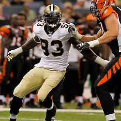 2009 August 14: New Orleans Saints defensive end Bobby McCray (93) rushes against Cincinnati Bengals offensive tackle Dennis Roland (74) during a preseason opener between the Cincinnati Bengals and the New Orleans Saints at the Louisiana Superdome in New Orleans, Louisiana.