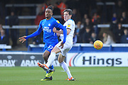 Ivan Toney is challenged by Jim McNulty during the EFL Sky Bet League 1 match between Peterborough United and Rochdale at London Road, Peterborough, England on 12 January 2019.