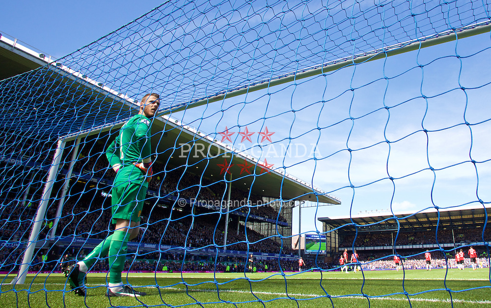 LIVERPOOL, ENGLAND - Sunday, April 26, 2015: Manchester United's goalkeeper David de Gea looks dejected as Everton's John Stones scores the second goal during the Premier League match at Goodison Park. (Pic by David Rawcliffe/Propaganda)