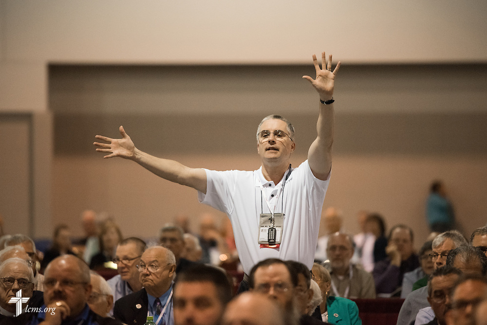 A delegate raises his hands on Tuesday, July 12, 2016, at the 66th Regular Convention of The Lutheran Church–Missouri Synod, in Milwaukee. LCMS/Frank Kohn