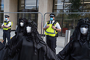 Climate Change and environmental activists from Extinction Rebellion, protest outside petrochemical corporation, Shell on London's Southbank, on 8th September 2020, in London, England. XR say that Shell is lobbying governments to extend the role of gas and the lifespan of the oil industry - jeopardising the Paris Agreement worldwide.