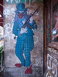 Detail of graffiti painted on wall in bohemian district of Prenzlauer Berg in Berlin Germany