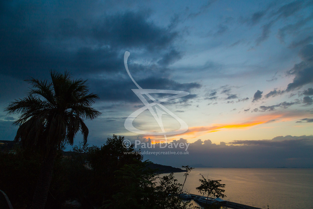 Sorrento, Italy, September 16 2017. A palm tree makes a silhouette after sunset in Sorrento, Italy. © Paul Davey