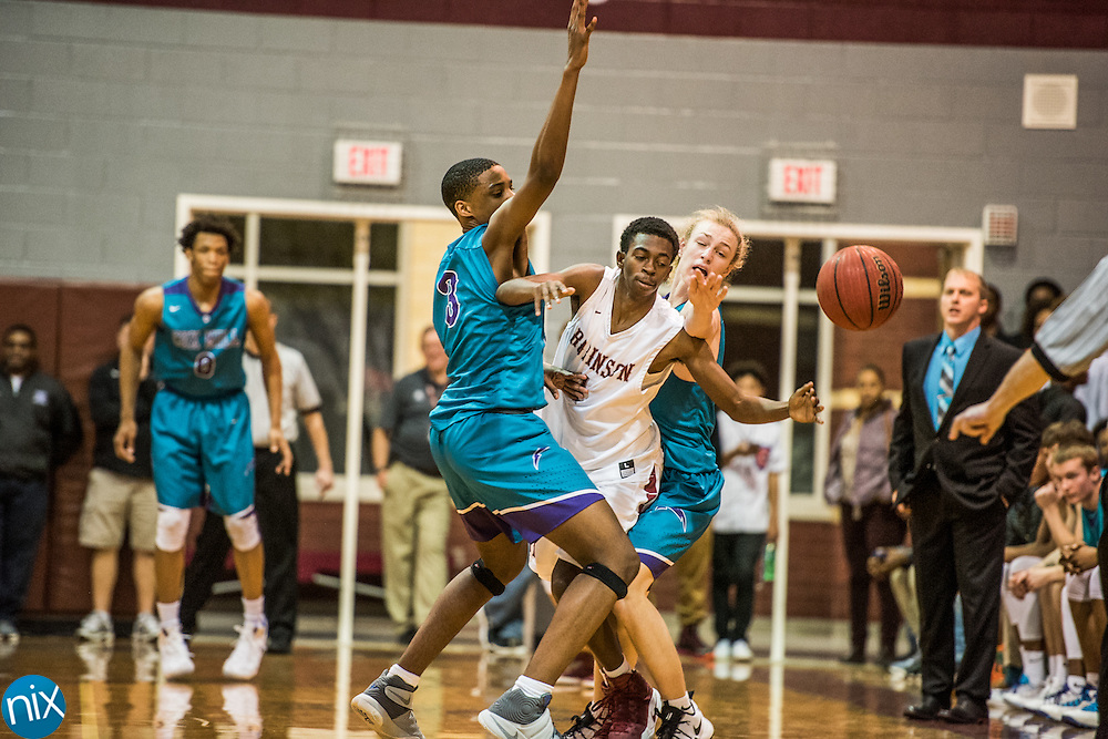Jay M. Robinson's Vi'chon Means (1) tries to get past Cox Mill's Caleb Stone-Carrawell (3) Wednesday night at Jay M. Robinson High School. The Bulldogs won 71-63.