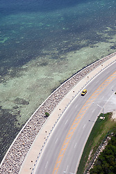 Aerial view of a yellow taxi driving along the coast, Key West, Florida, United States of America