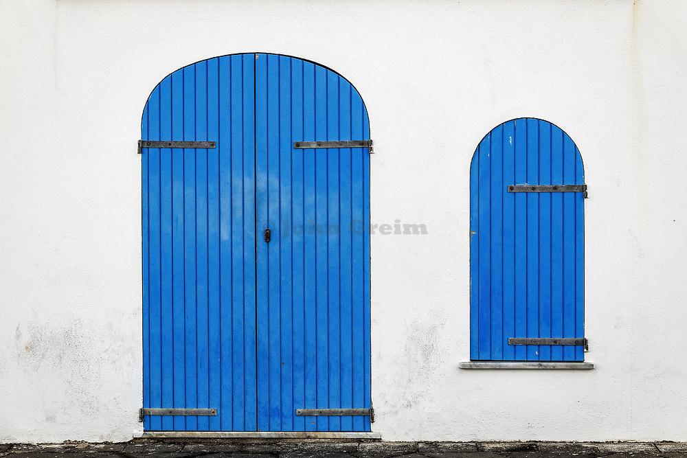 Blue door and shuttered window, Alghero, Sardinia, Italy.