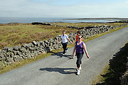 A weekend of glorious weather welcomed approximately 150 people from all over the country and abroad to Inis Mor , Arann Islands to participate in the annual Aer Arann half marathon.  Over the past ten years people have walked and ran the roads of Inis Mor to raise in excess of 1.2 million to purchase vital life saving equipment for sick children in both Crumlin and Temple Street hospitals.     Margaret  Lena and Karen Gill from the Island took part . Photo:Andrew Downes.