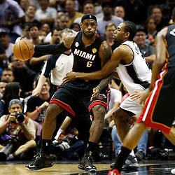 Jun 13, 2013; San Antonio, TX, USA; Miami Heat small forward LeBron James (6) drives against San Antonio Spurs small forward Kawhi Leonard (2) during the first quarter of game four of the 2013 NBA Finals at the AT&T Center. Mandatory Credit: Derick E. Hingle-USA TODAY Sports