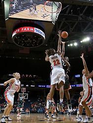Virginia Cavaliers Guard Monica Wright (22) blocks a shot by Miami Hurricanes guard Albrey Grimsley (20).  The University of Virginia Cavaliers defeated the Miami Hurricanes Women's Basketball Team 73-60 at the John Paul Jones Arena in Charlottesville, VA on February 4, 2007.