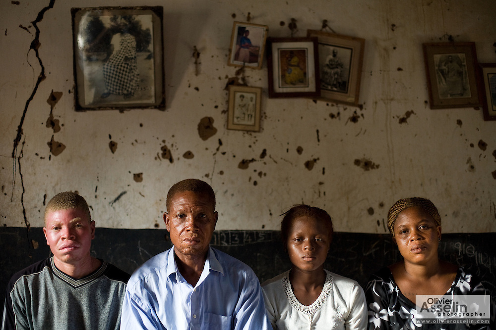 From left to right Steven Gamor, 32, Simon Obroni Gamor, 45, Sitsote Gamor, 28, and Paulina Gamor, 25 in their family's home in the village of Tefle Kpotame, Ghana on Tuesday April 22, 2008.