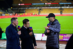 WOLVERHAMPTON, ENGLAND - Friday, December 21, 2018: Liverpool's manager Jürgen Klopp gives a post-match interview to Sky Sports pundits Jamie Carragher (L) and Gary Neville (C) after the FA Premier League match between Wolverhampton Wanderers FC and Liverpool FC at Molineux Stadium. Liverpool won 2-0. (Pic by David Rawcliffe/Propaganda)