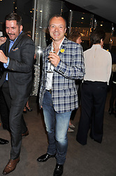 GRAHAM NORTON at the launch of Samsung's NX Smart Camera at charity auction with David Bailey in aid of Marie Curie Cancer Care at the Bulgari Hotel, 171 Knightsbridge, London on 14th May 2013.