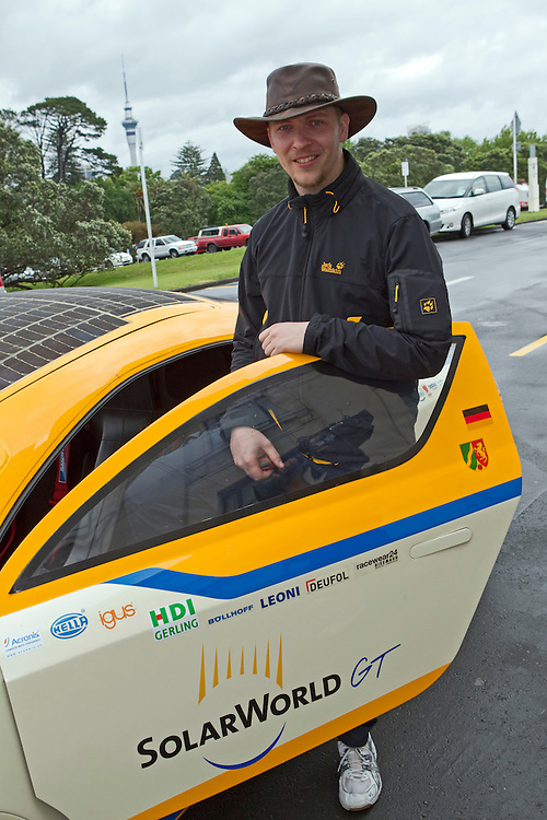 Tim Skerra from the University of Applied Sciences Bochum, Germany with the solar powered car SolarWorld GT as he departs to travel the length of New Zealand, Domain, Auckland, New Zealand, Thursday, November 24, 2011.  Credit:SNPA / David Rowland