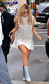 Kylie Jenner wears a short skirt as she arrives at a downtown hotel