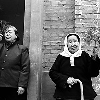 LIUJIAZHUANG VILLAGE, 8 APRIL 2001: two elderly women hold palm tree twiggs on Palm Sunday in an official church. China cut relations with the vatican in the early fifites and since then, established a Patriotic catholic Church that's controlled by Chinese authorities.<br />Catholics who refused to give up their ties with the Vatican, started worshipping in underground churches and consequently were persecuted for a long time. Since the late nineties though, relations with the vatican informally started to improve. Although China still has no diplomatic relations, many representatives from official churches met the pope John Paull II secretely . Since the pope's death on Saturday, thousands of catholics commemorate John Paull II  in special masses throughout China.