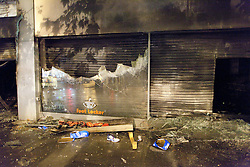 © Licensed to London News Pictures. 08/08/2011. Brixton, UK. Many shops are smashed and looted during another night of rioting and looting across London. Photo credit : Joel Goodman/LNP