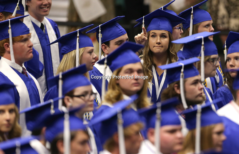 Adam Robison | BUT AT PHOTOS.DJOURNAL.COM<br /> A Saltillo graduating Senior points to family at the start of the Saltillo Graduation Ceremony at BancorpSouth Arena  Saturday night in Tueplo.