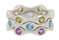 Triple stack gemstone rings on white background