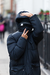 Yahya Egeh hides from the press as he leaves Westminster Magistrates Court where he was facing a charge of running up a bill at the Savoy of £2,146 including a £1,750 bottle of 2004 Chateau Mouton Rothschild before leaving without paying. London, January 11 2019.