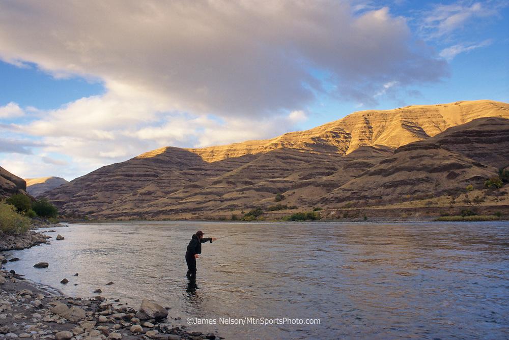 08007-W. An angler casts a fly for steelhead on the Snake River near Lewiston, Idaho.