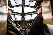 December 16, 2016<br /> Pilot Bill Sleeper (l) and Experimental Aircraft Association (EAA) volunteer, Edward Gregory (r), sit in the cockpit of a 1928 Ford Tri-Motor airplane on Friday, December 16, 2016. EAA is coordinating flights from the Pine Mountain Lake (PML) airport, Groveland, California. <br /> <br /> This Ford Tri-Motor NC9645, nicknamed The Tin Goose, has a wingspan of 77 feet 6 inches and was constructed in 1928. It was named the City of Wichita, and it was used to introduce the first coast-to-coast passenger air/rail service in the United States on July 7, 1929, and the development and inauguration of the first all air passenger service on October 25, 1930.<br /> <br /> Experimental Aircraft Association (EAA) is a worldwide organization of aviation enthusiasts. EAA&rsquo;s 185,000 members and 1,000 local chapters enjoy sharing their passion for flying, building and restoring aircraft. Pine Mountain Lake&rsquo;s EAA Chapter 1337 is hosting the airline&rsquo;s visit.