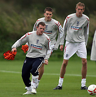 Photo: Paul Thomas.<br /> England Training. 06/10/2006.<br /> <br /> Wayne Rooney, Michael carricka and Peter Crouch.