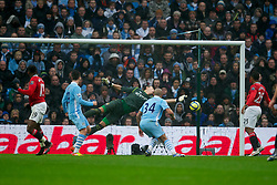 MANCHESTER, ENGLAND - Sunday, January 8, 2012: Manchester United's Danny Welbeck scores the second goal against Manchester City's goalkeeper Costel Pantilimon during the FA Cup 3rd Round match at the City of Manchester Stadium. (Pic by David Rawcliffe/Propaganda)
