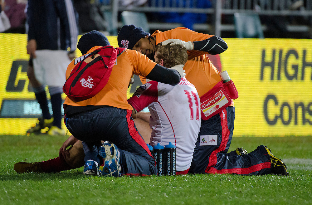 Reds Dom Shipperley gets medical attention after a tackle from the Crusaders in the Super Rugby qualifier match at AMI Stadium, Christchurch, New Zealand, Saturday, July 20, 2013. Credit:SNPA / David Alexander
