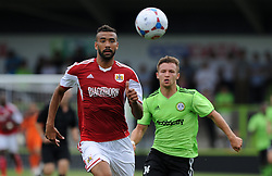 Bristol City's Liam Fontaine and Forest Green Rovers Matt Taylor - Photo mandatory by-line: Dan Rowley/JMP  - Tel: Mobile:07966 386802 20/07/2013 -Forest Green Rovers  vs Bristol City  - SPORT - FOOTBALL - Forest Green Rovers - Bristol city  -