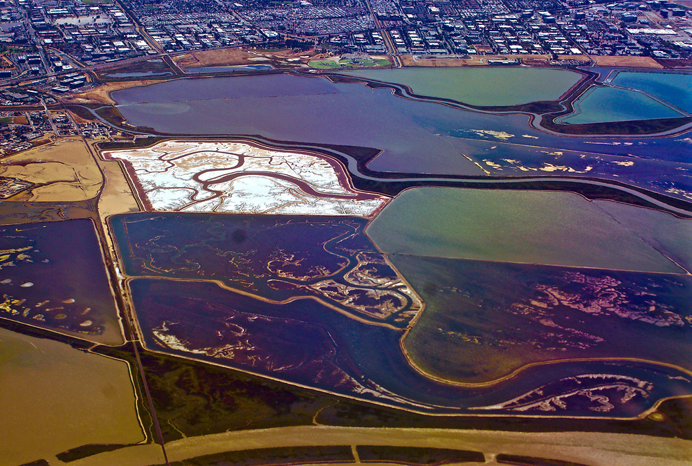 Aerial of salt flats and wetlands on approach to San Francisco airport from south.