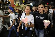 """La Dra Vanda Pignato junto a la diputada del parlamento Centroamericano Nery Bonilla marchan Saturday March 25, 2017 en la """"Marcha de los Farolillos"""" conmemorativa al XXXVII Aniversario de la muerte de Monseñor Orcar Arnulfo Romero. Photo: Franklin Rivera/fmln/Imagenes Libres."""