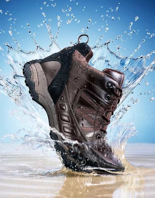 Hiking boot stamping down into water creating a splash in front of a light blue background Ray Massey is an established, award winning, UK professional  photographer, shooting creative advertising and editorial images from his stunning studio in a converted church in Camden Town, London NW1. Ray Massey specialises in drinks and liquids, still life and hands, product, gymnastics, special effects (sfx) and location photography. He is particularly known for dynamic high speed action shots of pours, bubbles, splashes and explosions in beers, champagnes, sodas, cocktails and beverages of all descriptions, as well as perfumes, paint, ink, water – even ice! Ray Massey works throughout the world with advertising agencies, designers, design groups, PR companies and directly with clients. He regularly manages the entire creative process, including post-production composition, manipulation and retouching, working with his team of retouchers to produce final images ready for publication.