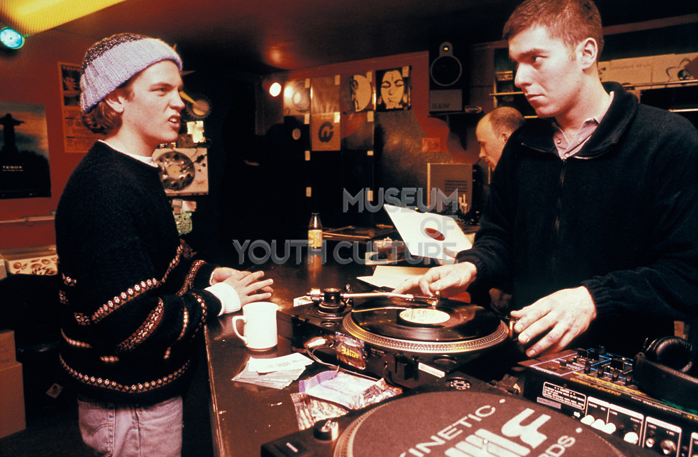 Two Men in a record shop playing vinyl,1998.