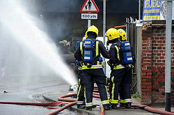 © licensed to London News Pictures. LONDON, UK . 19/04/2011. A fire that caused a section of the M1 to be closed for several days appears to have been started deliberately, the London Fire Brigade (LFB) has said. FILE PHOTOGRAPH DATED 15.04.11.Firefighters tackle a huge blaze at Apex Metals, a scrap dealership under the M1 motorway  between junctions 4 and 5 in Mull Hill. The fire closed both the motorway, and 2 of the four train lines in and out of London. Please see special instructions for usage rates. Photo credit should read Simon Jacobs/LNP