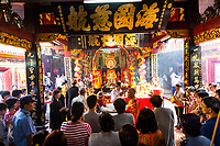 A large group of people gather to listen to monks praying at Quan Am pagoda in District 5, Ho Chi Minh City, Vietnam.