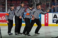 KELOWNA, CANADA - JANUARY 9:  Referees Stephen Campbell and Troy Paterson skate with linesman Dustin Minty and Josh Albinati at the Kelowna Rockets against the Everett Silvertips on January 9, 2019 at Prospera Place in Kelowna, British Columbia, Canada.  (Photo by Marissa Baecker/Shoot the Breeze)