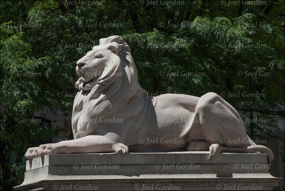 Patience and Fortitude, pair of marble lions statues stand proudly before the majestic Beaux-Arts New York Public Library building at Fifth Avenue and 42nd Street in Manhattan.