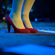 April 26, 2012 - New York, NY : Irish singer and songwriter Julie Feeney wore glittery high heels, this red pair being her second of two pairs of the evening, as she performed at the Irish Arts Center in Manhattan on Thursday night. CREDIT : Karsten Moran for The New York Times