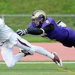 Bloomsburg's Ryan Dickerson (7) catches a diving pass for a touchdown, just out of reach of West Chester's Bob Sabol (2). TK4