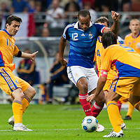 05 September 2009: French forward and captain Thierry Henry dribbles the ball surrounded by Romanian defenders during the World Cup 2010 qualifying football match France vs. Romania (1-1), on September 5, 2009 at the Stade de France stadium in Saint-Denis, near Paris, France.