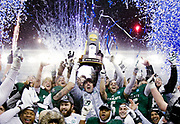 Northwest Missouri head coach Adam Dorrel, center, holds up the championship trophy after an NCAA Division II National Championship football game, Saturday, Dec. 17, 2016, in Kansas City, Kan. Northwest beat North Alabama 29-3.  (AP Photo/Colin E. Braley)