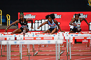 Kendra Harrison aka Kendra Harrison (USA) right leads Janeek Brown (JAM) in the heats of the women's 100m hurdles during the Birmingham Grand Prix, Sunday, Aug 18, 2019, in Birmingham, United Kingdom. (Steve Flynn/Image of Sport via AP)
