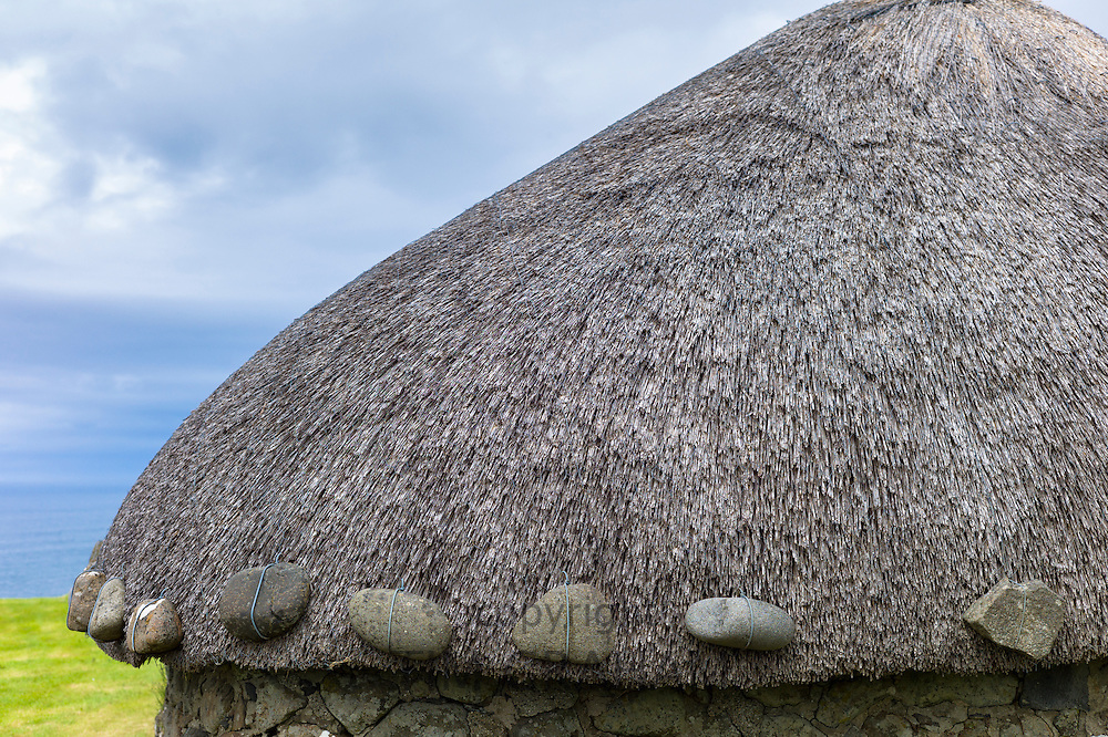 Detail of thatched roof weighted with stones at tourist attraction Skye Museum of Village Life depicting thatched stone croft cottages at Kilmuir, Isle of Skye, the Western Isles of Scotland, UK