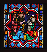 Adoration of the Magi, detail from the main stained glass window or maitresse-vitre of the chevet, made 1280-90 and restored in the 17th, 19th and 20th centuries, in the Cathedral Saint-Samson, begun in the 13th century on the site of an older church and completed in the 18th century, in Dol-de-Bretagne, Brittany, France. The window consists of 8 lancets depicting the lives of saints who have relics in the cathedral, and a tympanum of glass depicting the Last Judgement. The cathedral is dedicated to one of the founding saints of Brittany and until 1801 was the seat of the archbishopric of Dol. Picture by Manuel Cohen