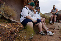 Guests at the Biggest Loser Resort in Ivins, Utah (L-R) Jerry Murray, Everett Blair and Jennifer Gillette rest on one of their daily hikes September 6, 2010.  Guests at the resort affiliated with the popular reality television show hike for miles each day as part of their 6 to 7 hours of workouts. REUTERS/Rick Wilking (UNITED STATES)